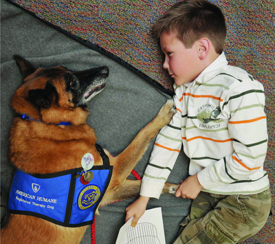 American Humane Association is exploring the remarkable healing power of animal-assisted therapy for children with cancer. (PRNewsFoto/American Humane Association)