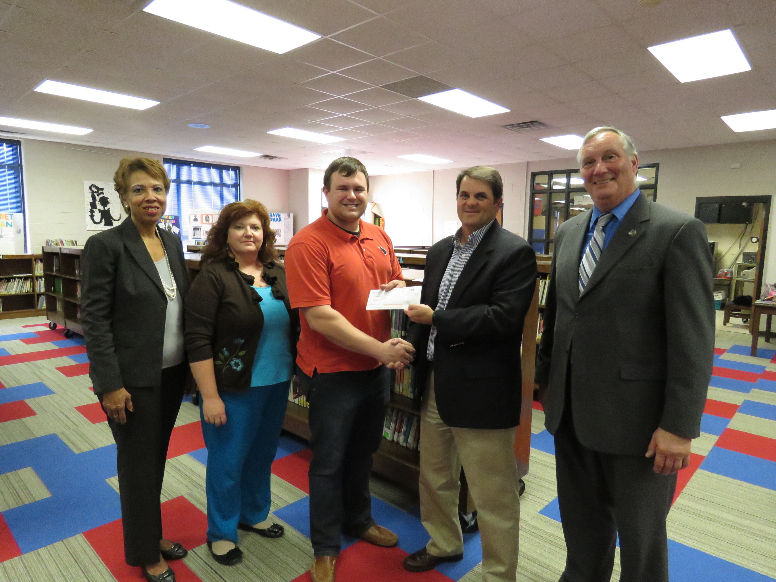 Georgia Power announced the selection of 41 new teachers from across the state to receive one of the company's annual $1,000 New Teacher Assistance Grants. Pictured is Caleb McKeever, of Milledgeville receiving his New Teacher Assistance Grant check.