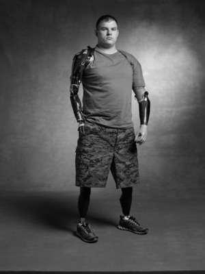 Help get US Army Weapons Squad Leader, Travis Mills, off the waiting list and into a Building for America's Bravest home so he can regain his independence, OurBravest.org.  (PRNewsFoto/Building for America's Bravest)
