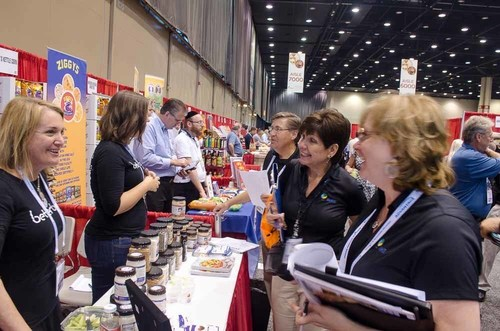 Retailers and Suppliers do business at KeHE's 2014 Holiday Show. The event saw a 256% increase in show floor orders placed, breaking company records. (PRNewsFoto/KeHE Distributors)