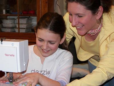 Laura Kelly teaches her daughter Devon to use a sewing machine at The Handwork Studio.  (PRNewsFoto/The Handwork Studio)
