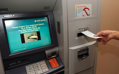 Stacks of checks or cash can be deposited without an envelope 24/7, 365 days a year.  (PRNewsFoto/PNC Bank)
