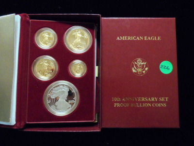 Silver and gold coins.  (PRNewsFoto/Back to the Past Collectibles)