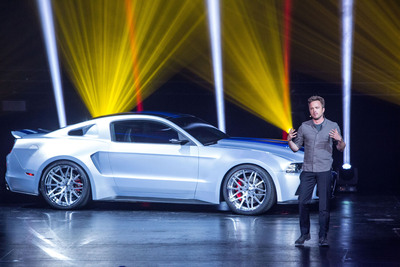 Aaron Paul, lead actor in the upcoming movie Need for Speed based on the Electronic Arts video game franchise, unveils his character's ride of choice, a 900-horsepower, custom-built Ford Mustang during a press conference at the E3 Conference in Los Angeles.  (PRNewsFoto/Ford Motor Company)