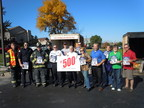 Bartlett fire officials and representatives from the nonprofit Northern Illinois Fire Sprinkler Advisory Board celebrate Illinois' 500th side-by-side fire sprinkler demonstration on October 25.