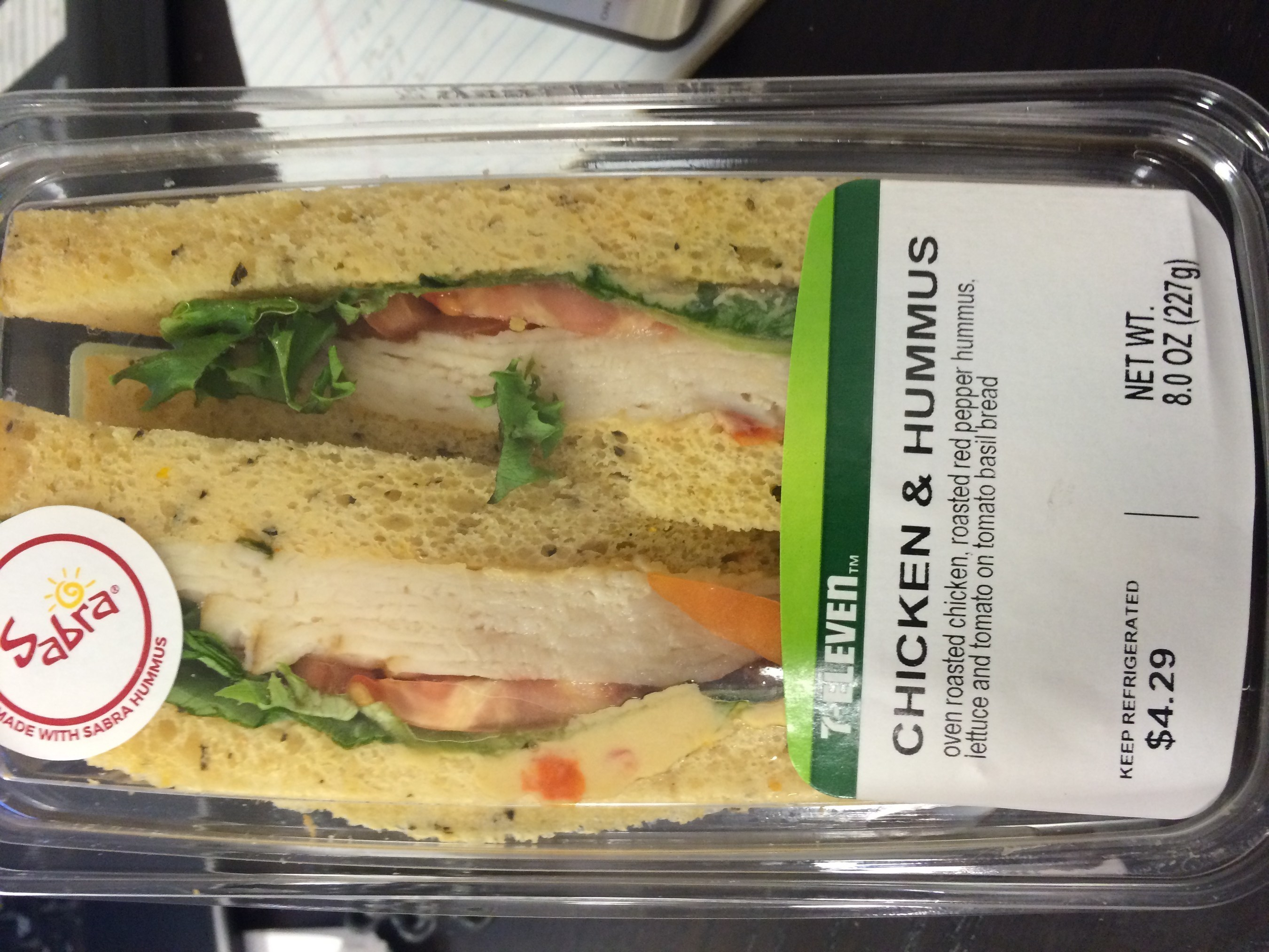 7 Eleven Chicken with Hummus sandwiches, packaged in a plastic clam shell, net wt. 8 oz., UPC  0 52548 58888 5