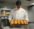 SUBWAY restaurant chain recognizes its bread suppliers for making its bread even better! SUBWAY Baking Specialist Mark Christiano pulls freshly baked bread from the oven.