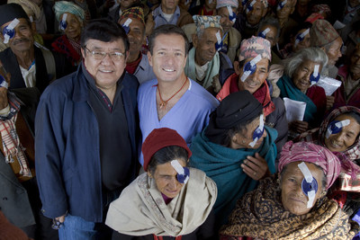 Drs. Sanduk Ruit (left) and Geoffrey Tabin (right) among patients in Dolakha, Nepal.