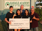 Kamaile Academy students Ian Sholtis, Rexel Boter and Coepland Talkington receive a Verizon Innovative Learing Grant from Edward Wright of Verizon Hawai'i.