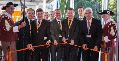 Pictured from front left to right: Armin Tremel, Senior Manager, Facilities, TE Automotive EMEA; Director General Dr. Bernhard Schwab, Bavarian State Ministry of Economic Affairs, Media, Energy & Technology; Dr. Christoph Hammer, Head of Mayor, City of Dinkelsbuehl; Dr. Jurgen Ludwig, Ansbach District Administrator; and Hermann Regele, Operations Manager for TE Automotive's Dinkelsbuehl facility during the ribbon cutting ceremony with other TE Automotive leaders and event attendees. (PRNewsFoto/TE Connectivity)