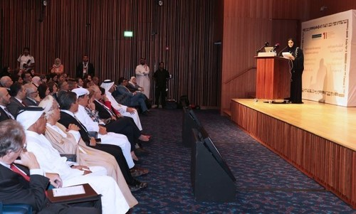 Dr. Amal Al Malki, Executive Director of the Translation and Interpreting Institute, addresses the audience at ...