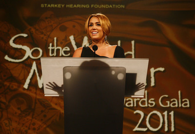 Miley Cyrus addresses more than 1,600 attendees at the Starkey Hearing Foundation's So The World May Hear Awards Gala and discusses her moving experience while participating in a recent mission to Haiti, where she helped deliver the gift of hearing to children and adults. Photography credit: Los Enterprises for the Starkey Hearing Foundation.   (PRNewsFoto/Starkey Hearing Foundation)