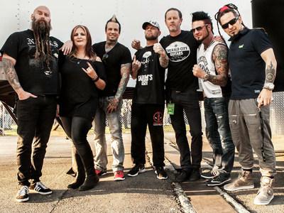 Left to right in photo: Bassist Chris Kael, Manager Jackie Kajzer, Drummer Jeremy Spencer, singer Ivan Moody, Rise Record's Craig Ericson, guitarist Jason Hook & guitarist Zoltan Bathory