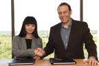 Feng Na, COO of Shijie99 with Sabre president and CEO Tom Klein at Sabre's global headquarters in Southlake, Texas, USA