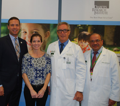 Diabetes Research Institute Foundation President & CEO Joshua Rednik (left) and the Diabetes Research Institute's Drs. Camillo Ricordi, director, and Rodolfo Alejandro, director of clinical islet transplantation, with BioHub trial patient Wendy Peacock, who is now free from insulin injections.