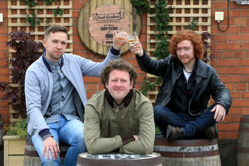(l-r David C. Clements and Tony Wright of VerseChorusVerse) David C Clements and VerseChorusVerse are announced as the 2013 recipients of the Bushmills Live Legacy Fund. They are pictured toasting with a Bushmills Irish Whiskey at Bush Gardens on the roof of the Oh Yeah Centre. Pictured with these emerging Northern Irish artists is Davy Matchett of artist development company Third Bar. Third Bar's Davy Matchett and Gary Lightbody have joined forces with Bushmills Irish Whiskey to create and curate the Legacy Fund. (PRNewsFoto/BUSHMILLS IRISH WHISKEY)