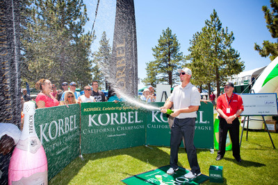 Former MLB All-Star Third Baseman Chipper Jones shows incredible style with his spray after popping the cork during the seventh annual Korbel Celebrity Spray-Off in Lake Tahoe on July 18, 2013.  (PRNewsFoto/Korbel)
