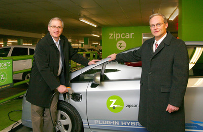 (left to right) Scott Griffith, Chairman and CEO of Zipcar, and Frank Miller, Regional Distribution Manager, Toyota Motor Sales, stand in front of one of the new Toyota Prius PHVs to enter the Zipcar Fleet in Cambridge, Mass.  (PRNewsFoto/Zipcar)