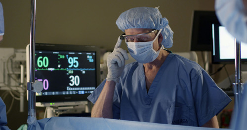 Anesthesiologist Dr. Feinstein in an OR simulator lab tests viewing IntelliVue vital signs via Google Glass. ...