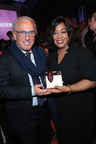 Designer Roberto Coin and Shonda Rhimes with the Sherry Lansing Leadership Award