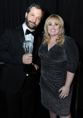 Judd Apatow toasts his Critics' Choice LOUIS XIII Genius Award with Rebel Wilson at the Critics' Choice Movie Awards at Barker Hangar on Thursday, January 10, 2013 in Santa Monica, Calif.  (PRNewsFoto/Louis XIII de Remy Martin, Jordan Strauss/Invision)