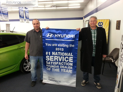 Fountain Valley, Calif., Feb. 19, 2014 - Texoma Hyundai in Sherman, Texas ranked number one in service customer satisfaction in the of the United States for 2013 besting more than 820 Hyundai dealerships nationally. Texoma Hyundai was also the number one dealer in Hyundai's South Central Region. There are 154 dealers in Hyundai's South Central Region. Holding the banner are Jason Brewer, service manager, Texoma Hyundai and Clint Davis, service advisor, Texoma Hyundai.  (PRNewsFoto/Hyundai Motor America)