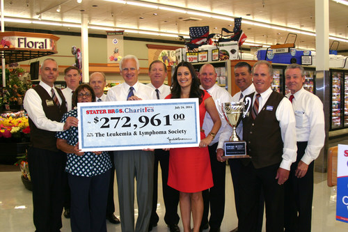 Stater Bros. President and COO, Pete Van Helden (center) along with Stater Bros. representatives present a ...