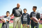Head Football Coach, David Shaw is photographed with youth from the Boys & Girls Club of the Peninsula. Shaw believes his job as a coach is to keep irritations and distractions at bay, so players can be successful during competition, in the classroom and after graduation. Dove Men+Care Deodorant - the brand best known for providing care to help end underarm irritation, so that men can focus on what matters most - partnered with Shaw to launch the 'Care Always Wins' campaign. Together they will honor coaches who foster caring environments, highlighting how a coach's care has the power to ease irritations. (PRNewsFoto/Dove Men+Care/Unilever)