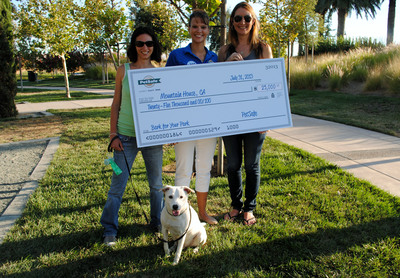 PetSafe employees celebrate with residents of Mountain House, Calif., the winner of the 2013 'Bark for Your Park' small city category. Mountain House won $25,000 toward building a PetSafe off-leash dog park in the community. Pictured from left to right: Fiona Mayne, president of the Mountain House Dog Club, with her dog, Buckley; PetSafe senior brand manager Robin Rhea; and Amanda Avila, vice president of the Mountain House Dog Club.  (PRNewsFoto/PetSafe)