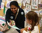 """Families at Skokie Public Library in Illinois participate in a Dia program (photo courtesy of the Association for Library Service to Children)."""""""