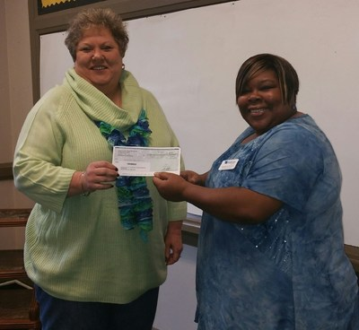 Nancy Blount, executive director, Lincoln County Family Partnerships, Inc. (on the left) receives the check from Shakela Williams, community advocate for WellCare of Georgia.