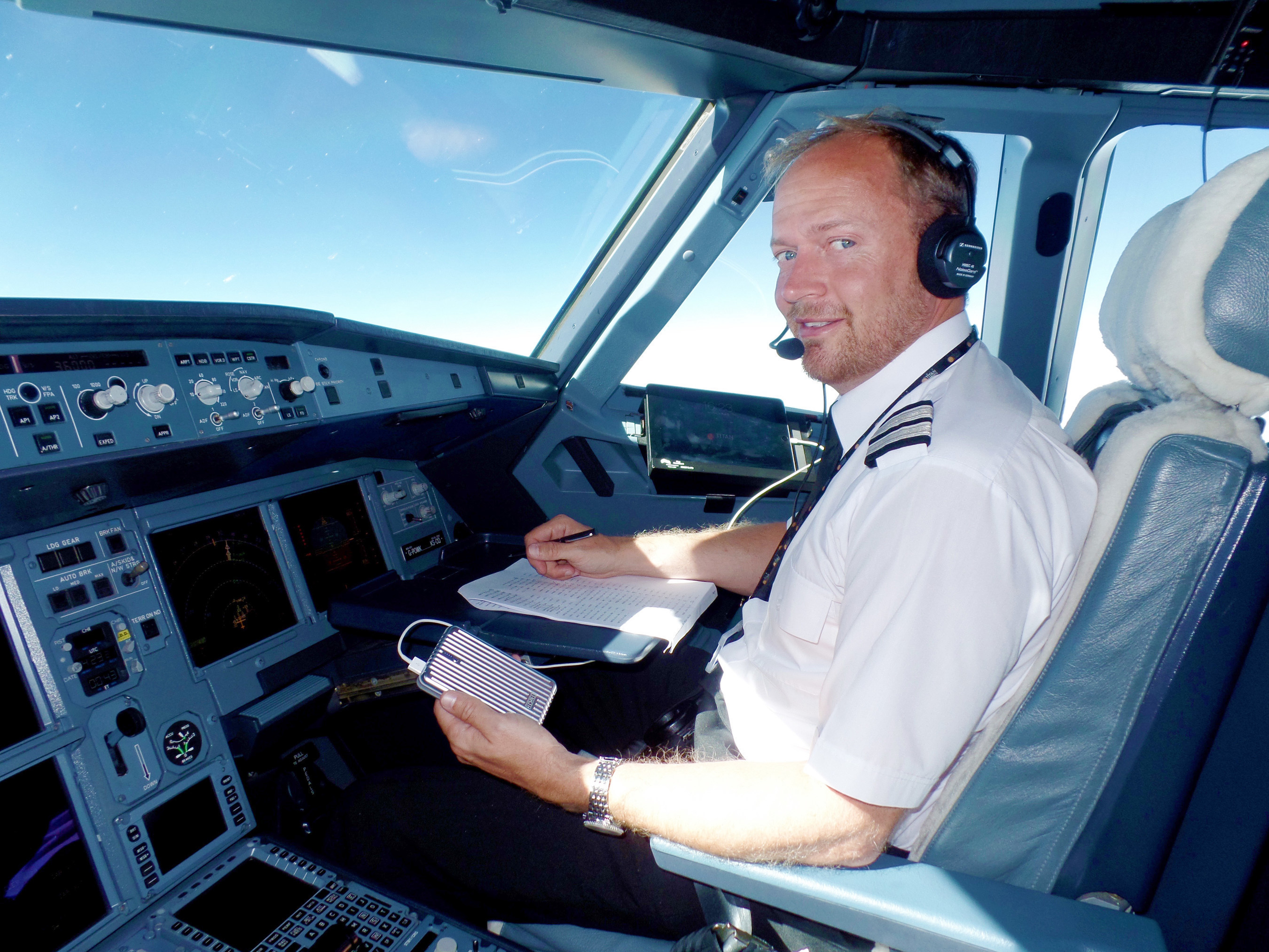 """Titan Airways A320 First Officer Oliver Pickstock Holding the Zendure A5 External Battery during a Flight. """"It's a great product, allowing us to get maximum utilization from our EFBs."""" said Titan Airways A320 First Officer Oliver Pickstock, """"It's stylish and provides loads of power."""""""