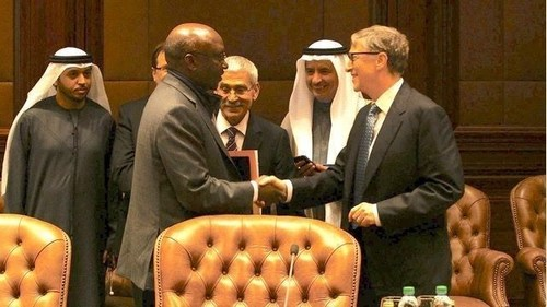 Bill Gates shakes hands with Dr. Donald Kaberuka, former President of the African Development Bank. ...