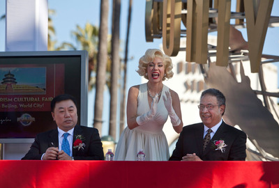 Universal Studios Hollywood's Marilyn Monroe joins Beijing Municipal Commission of Tourism Development Deputy Director Yu Debin and LA Tourism President & CEO Ernest Wooden Jr. in signing a Memorandum of Understanding in celebration of the Beijing Tourism Cultural Fair which opened at the theme park today and runs through January 6, 2013.  (PRNewsFoto/Universal Studios Hollywood)