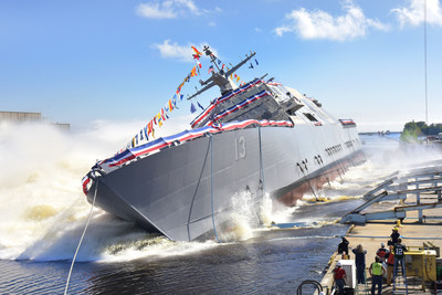 The 13th Littoral Combat Ship, the future USS Wichita launches sideways into the Menominee River in Marinette, Wisconsin, on Sept. 17. Once commissioned, LCS 13 will be the third ship to carry the name of Wichita, Kansas.