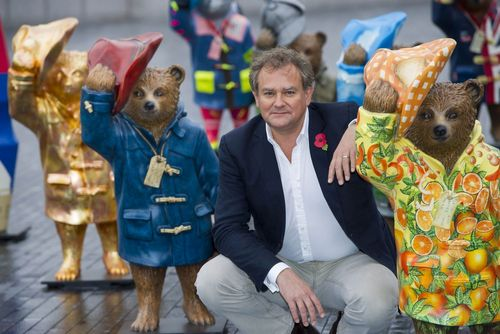 Actor Hugh Bonneville attends the launch of The Paddington Trail, in London. 50 Paddington statues will be placed across the capital including museums, parks, shops and landmarks, all with a colourful, Paddington inspired flavour. (PRNewsFoto/London and Partners)
