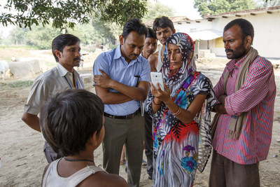 HelpMeSee staff and partners train a community health worker on the GIS-GPS app near Chitrakoot, India.