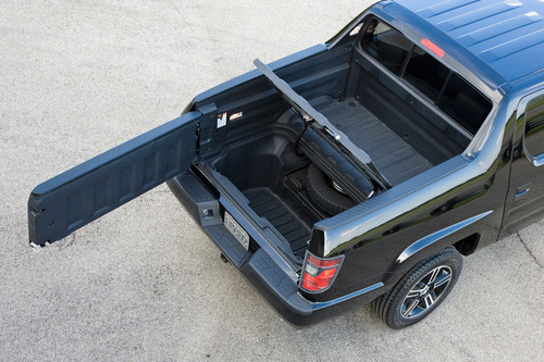 The versatile trunk bed offers features that cannot be found in any other pickup truck.  (PRNewsFoto/Benson Honda)