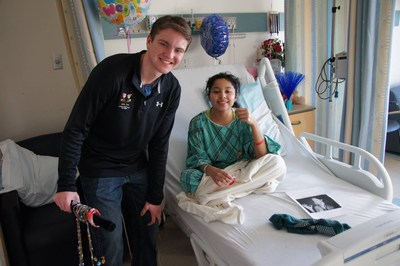 Ray Mohler Jr. visiting children at a Hospital in New York.