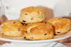 In honor of National Raisin Day, the California Raisin Marketing Board is sharing award-winning inspiration for celebrating this special April 30 holiday.  The Raisin and Citrus Scone recipe was a judge favorite created by Ian Regino at the recent inaugural Pastry Chicago Scone Competition.  (PRNewsFoto/California Raisin Marketing Board)