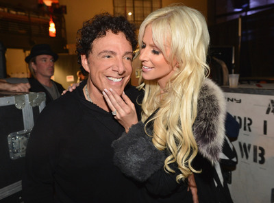 Journey's Neal Schon and Michaele Salahi get apology from the Daily Mail for false report.  (PRNewsFoto/Neal Schon and Michaele Salahi, Rick Diamond)