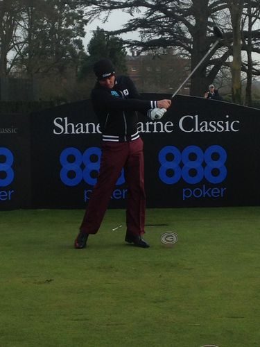 Shane Swing – Look at the follow through! Shane Warne hits a long drive off the first tee at the Grove Luxury  ...