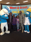 The Baggett family poses with Smurfette and Clumsy at Joint Base Lewis-McChord.  (PRNewsFoto/Sony Pictures Home Entertainment)