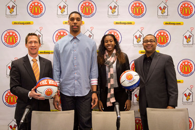 Joe Wootten, Head Basketball Coach of Bishop O'Connell in Arlington, Va., (left) and Douglas Freeland, Director of the McDonald's All American Games (right) recognize the 2014 McDonald's All Americans Jahlil Okafor (left center) and Ariel Atkins (right center) as the 2014 Morgan Wootten Players of the Year at the Ronald McDonald House on Tuesday, March, 25, 2014 in Chicago. (PRNewsFoto/McDonald's) (PRNewsFoto/MCDONALD'S)