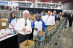 World Champion boxers Timothy Bradley and Austin Trout knock out hunger with USANA Founder Dr. Myron Wentz and co-CEO Dave Wentz at Children's Hunger Fund Food Pak event.