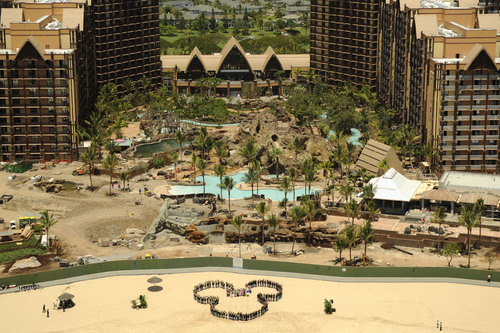 TIME TO ADD THE MAGIC - The crew from Hawaiian Dredging Construction Company, Inc., took to the beach fronting ...