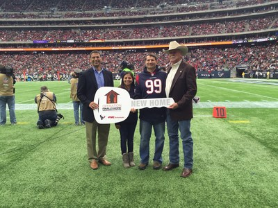 "FMC Technologies Vice President Barry Glickman (far left) and Operation FINALLY HOME Founder Dan Wallrath (far right) surprised retired U.S. Army veteran Israel ""Izzy"" Raylan Hillyer and his wife with a new, mortgage-free home at the Houston Texans Salute to Service game, November 22, 2015."