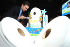 Jumbo Roll Toilet Paper turns 25.  Since 1985, nearly 2 billion pounds of toilet paper have been used throughout North America in airports, restaurants, stadiums and other locations away from home. Andy Clement, tissue business director for Kimberly-Clark Professional, commemorates the event by slicing a jumbo-sized cake shaped like rolls of toilet paper at the ISSA/Interclean trade show in Orlando, Fla.  The cake was then shared with hundreds of company customers.  (PRNewsFoto/Kimberly-Clark Professional, Bob Goldberg)