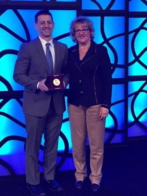 Health Leads President Rocco Perla accepts the Deming Medal from ASQ Chair Patricia La Londe at the 70th ASQ World Conference held in Milwaukee, Wis. The international award, which honors those who combine the application of statistical thinking and management so that each supports and enhances the other, was bestowed in honor of Perla's visionary approach to healthcare quality improvement.