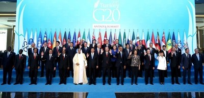 """As G20, our objective is to ensure strong, sustainable and balanced, and starting with this year, inclusive growth. Inclusiveness is significant to create quality employment, raise living standards, eliminate inequalities and spread prosperity. We agreed for the first time on a quantitative target to reduce the share of vulnerable young people in the labor market by %15 by 2025. We created WOMEN-20 official engagement group to help monitor the implementation of the G20 commitment to reduce the gender gap in labour force participation rates by 25% until 2025."" President Erdogan speaking at the Press Conference following the G20 Summit (PRNewsFoto/G20 Turkish Presidency) (PRNewsFoto/G20 Turkish Presidency)"
